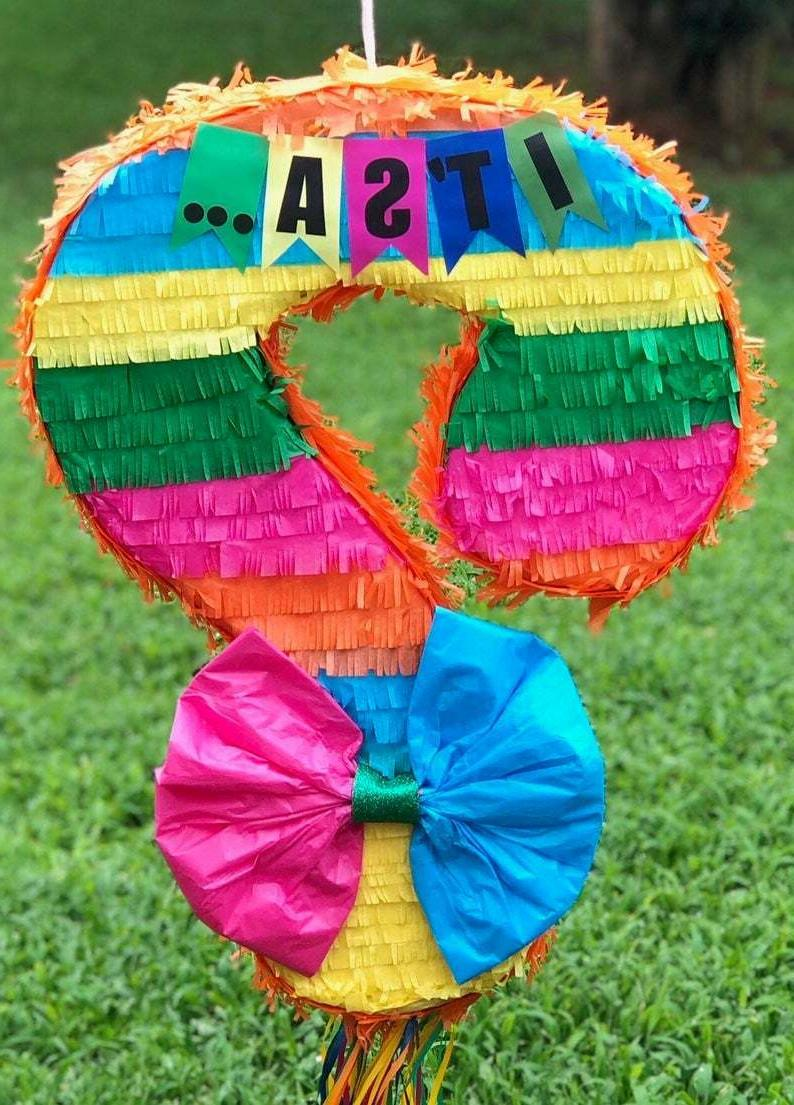 gender reveal pinata and table cloth